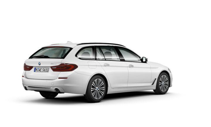 Vista Tres cuartos trasera izquierda del BMW Serie 5 520d Touring